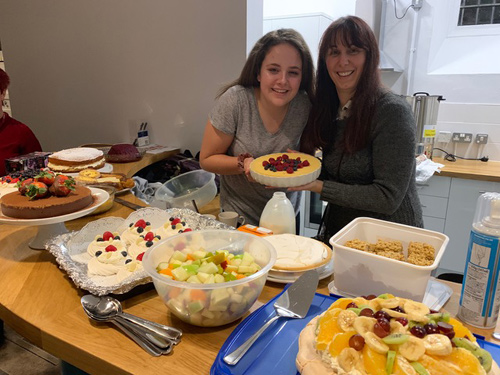 Abi Wilson and Diane Paddon serving puddings