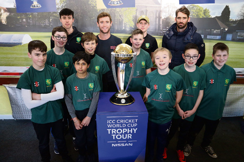 Members of Downend Cricket Club's under-13s with Gloucestershire players Ian Cockbain and Chris Liddle
