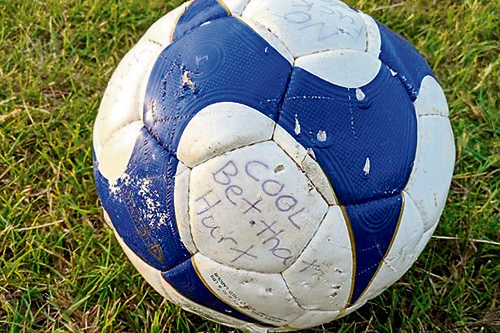 A FOOTBALL which had been filled with concrete and left with a sinister note saying 'Bet that hurt' has sparked anger among members of the community.
