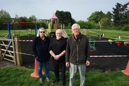 Lara Southwell, Clive Heath and Michael Bell at the park on the morning after the arson attack