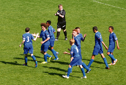 Ethan Spencer congratulates Dan McBeam, after scoring Downend Schools 2nd goal in their 2-0 victory in the National School's U13 cup final at Madejski Stadium
