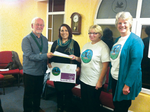 Graeme Riley receives the petition from Victoria Veasey, Fiona Konteh and Mary Lewis