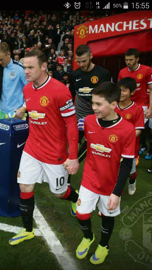 Kobe, 10, walks out at Old Trafford with Rooney