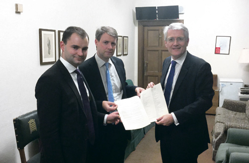 Luke Hall, left, and Chris Skidmore, hand the petition over to Andrew Jones