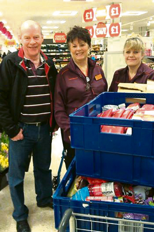 Steve Riches, from the foodbank, with Tracy Cannard and Jo Varney, from Sainsbury's
