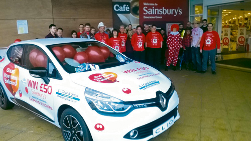 Customers at Sainsbury's in Emersons Green had to guess how many red balloons were inside a Renault Clio from SJ Cook in a competition to raise money for Comic Relief.