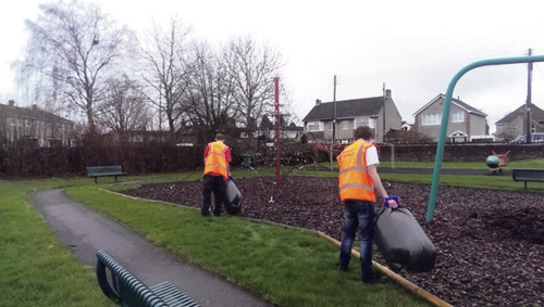 Teams of service users are pictured litter picking to help spruce up Downend and Mangotsfield.