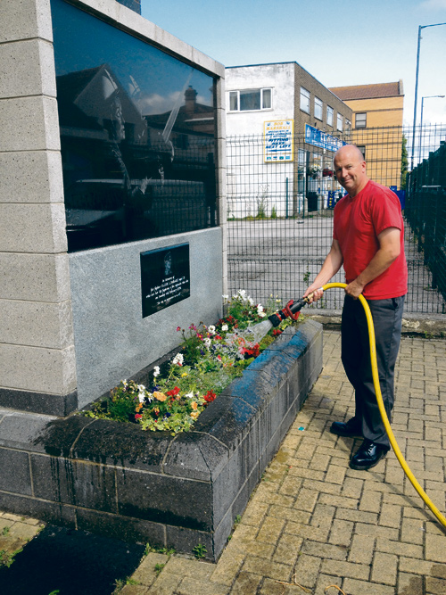 Firefighter Rich Iles makes sure Fleur Lombard's memorial in Staple Hill is looking its best