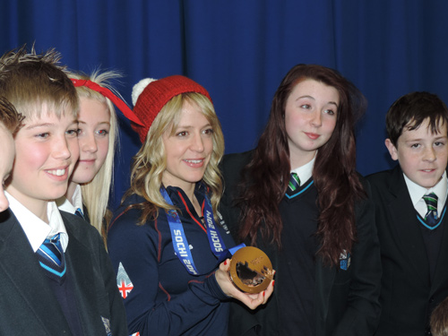 jenny jones posing for photos with downed school pupils