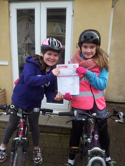 TWO schoolgirls have used pedal power to help a charity which is close to their hearts.